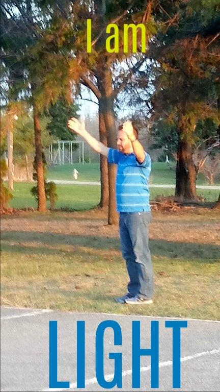tim STANDING ARMS IN AIR I AM LIGHT